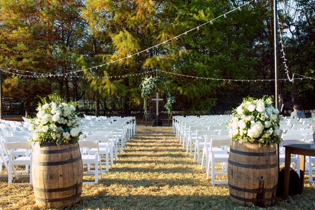 the ceremony site our whiskey barrels fruitwood or white wash are available and a great way to add a rustic feel and personalize your ceremony space