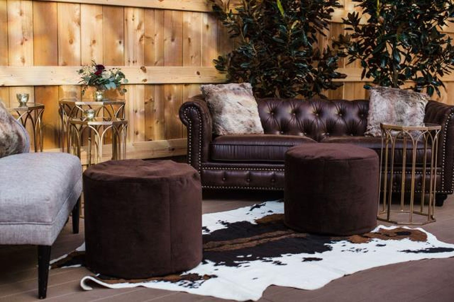 brown leather sofa and cowhide rug