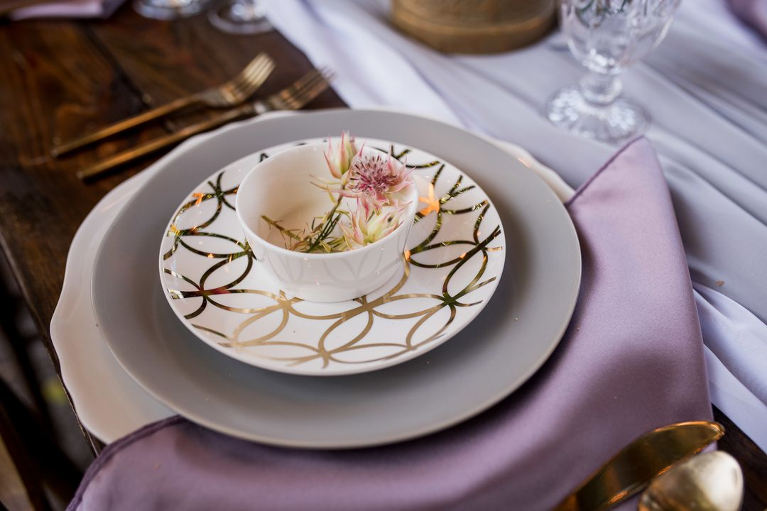 pastel tablescape with earthen china and Darcy charger