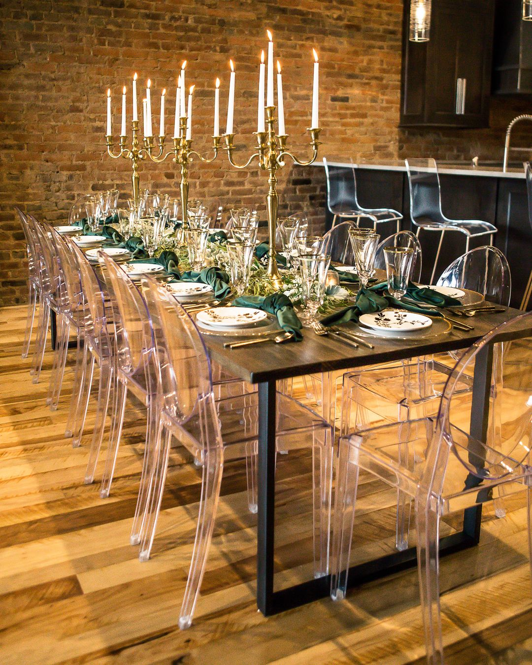 ghost acrylic chairs and industrial table