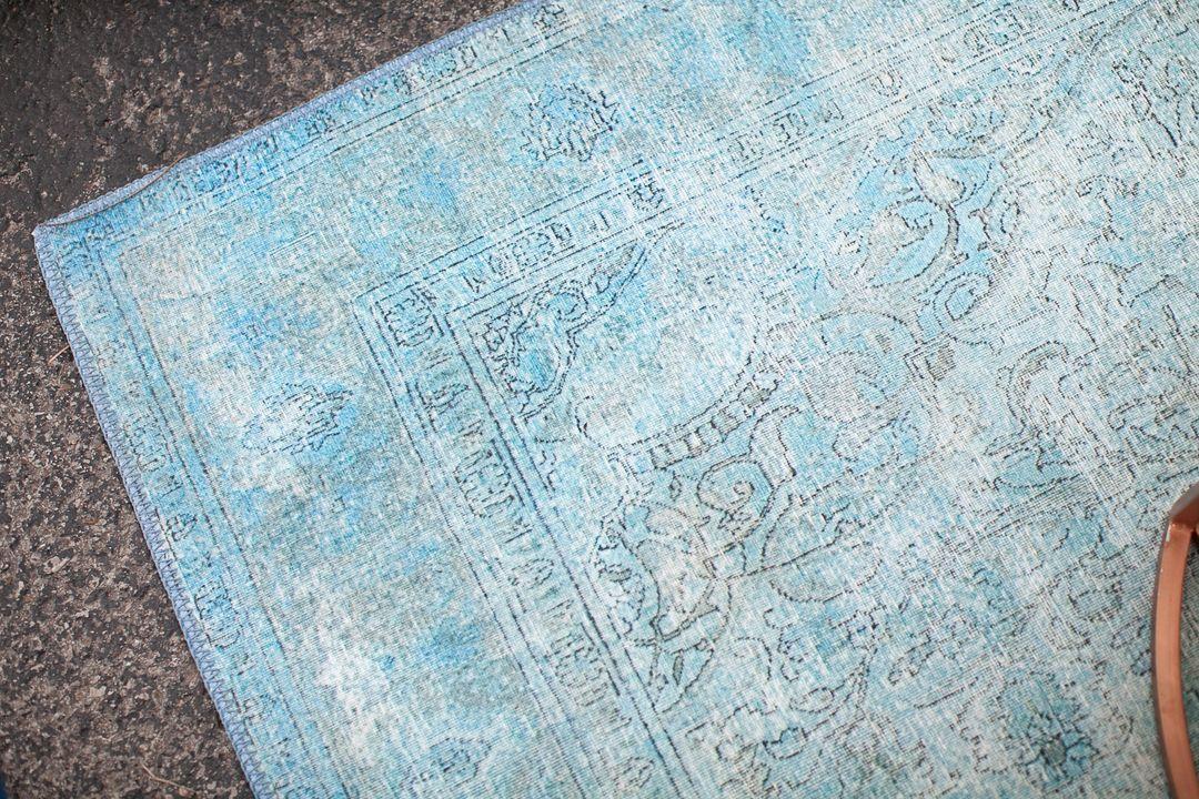 bright boho aqua rug for rent