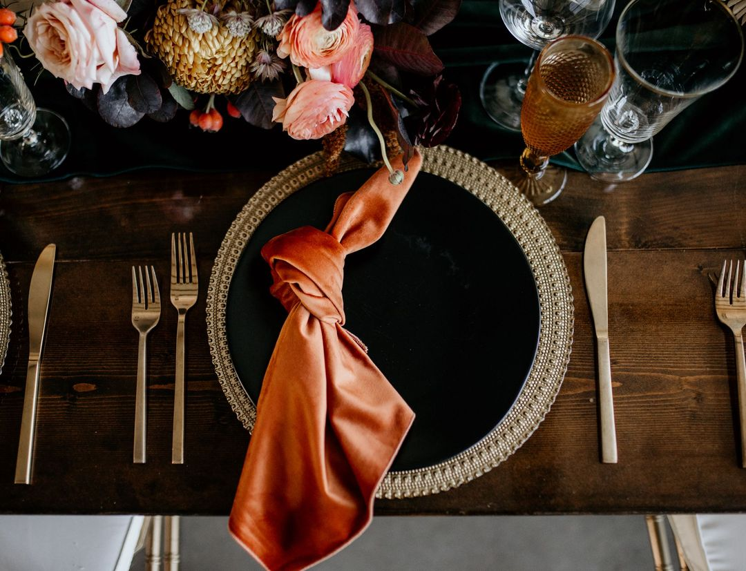 rust black and gold tablescape