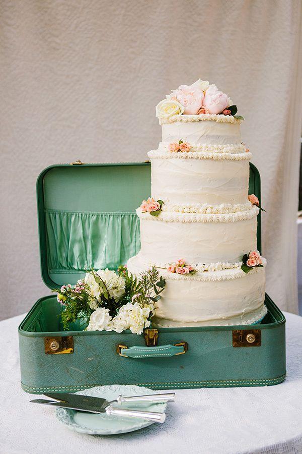 suitcase cake display via weddingchicks