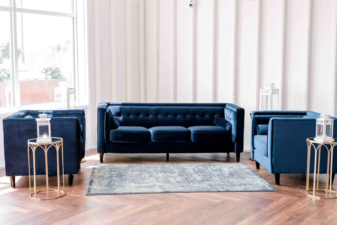 area rug and blue velvet furniture