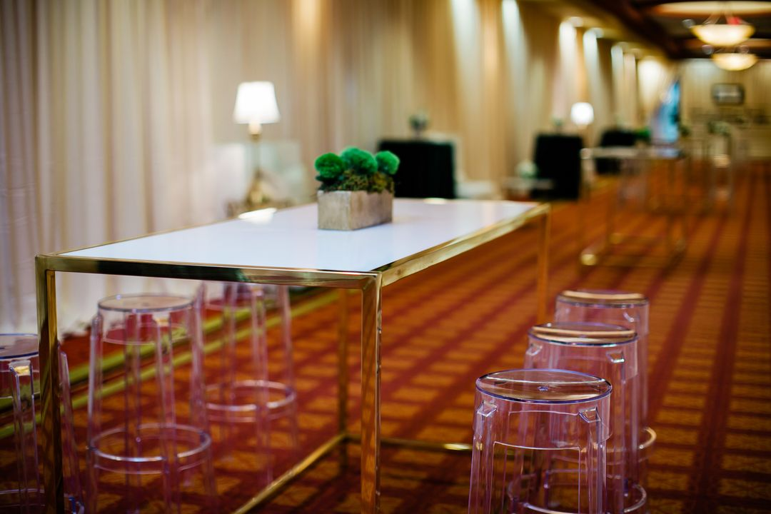 acrylic chairs with gold bistro table