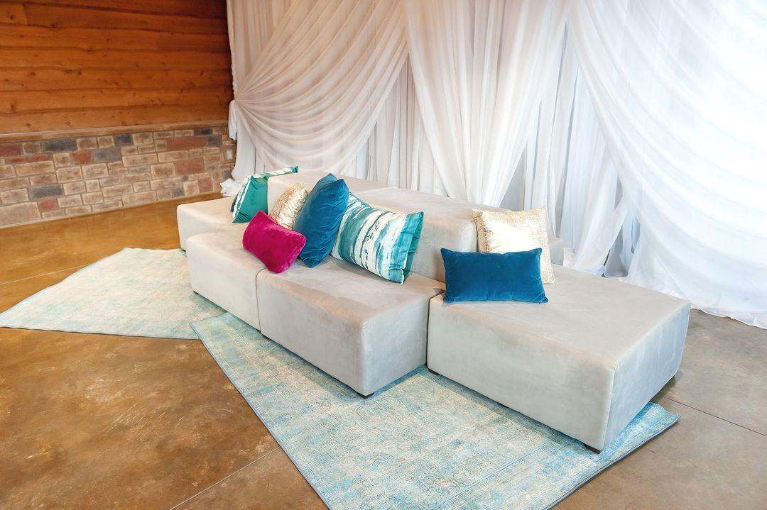 light blue rug beneath modular lounge