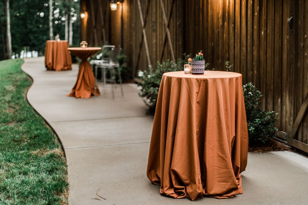 spice colored cocktail table linens for rent