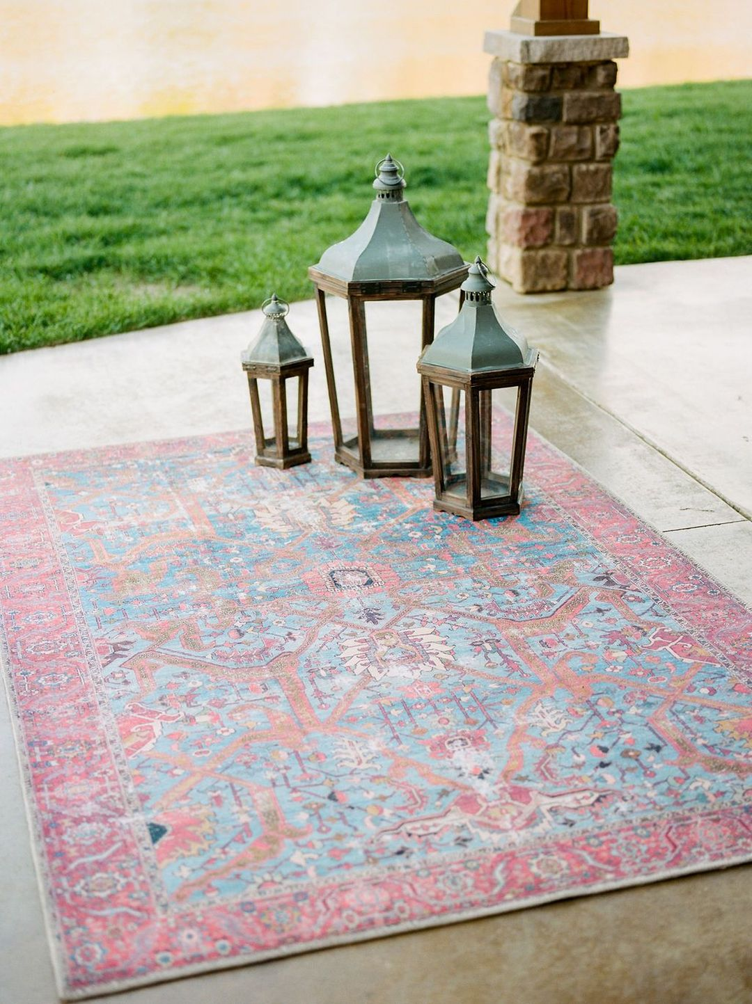 floor lanterns & red-blue rug