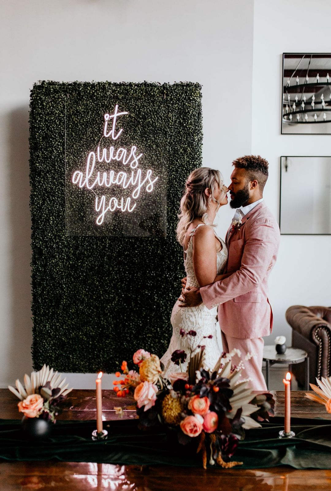 neon light and boxwood wall photo backdrop